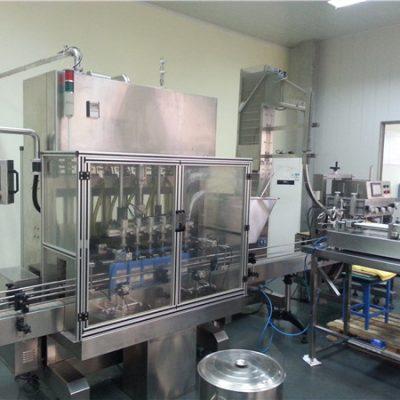 Stroj za automatsko punjenje motornim uljem sa 6 glava